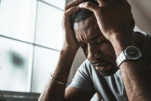 Man experiencing mental anguish
