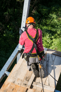 Worker using a personal fall arrest system