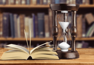 hour glass and book