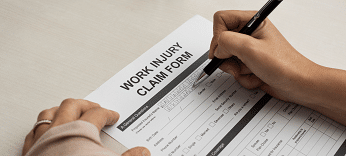individual filing out a work injury claim form