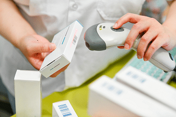 pharmacist scanning medication
