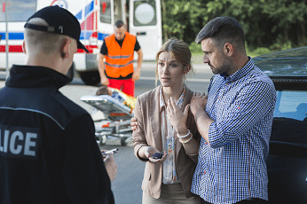 couple talking to police after car accident