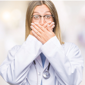 doctor with hands over her mouth